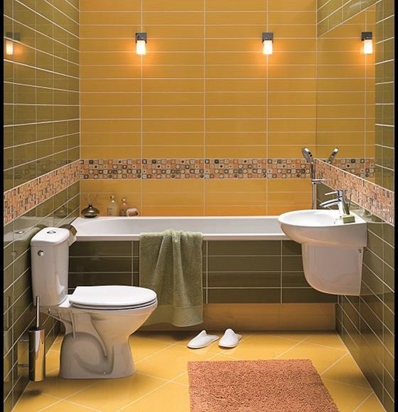 Ванная комната с ванной и компактным туалетом от KOŁO